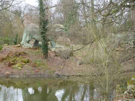 A dinosaur emerges from the trees,  Crystal Palace Park