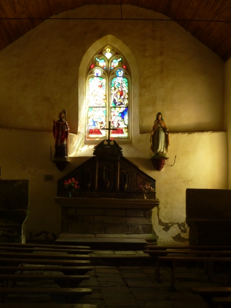 The gloomy interior of the chapel of St Clair