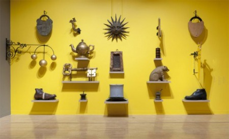A wall of shop signs in British Folk Art at Tate Britain