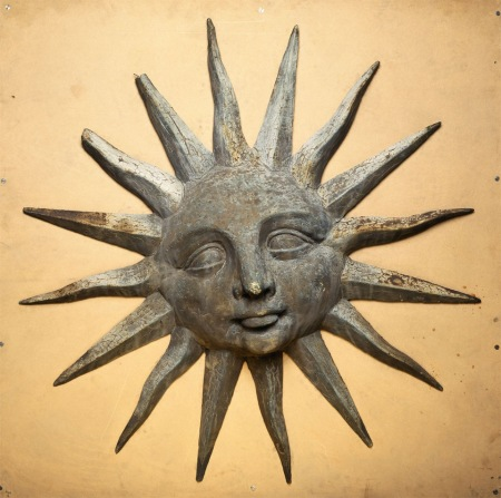 An iron shop sign in the shape of a sun from British Folk Art, Tate Britain