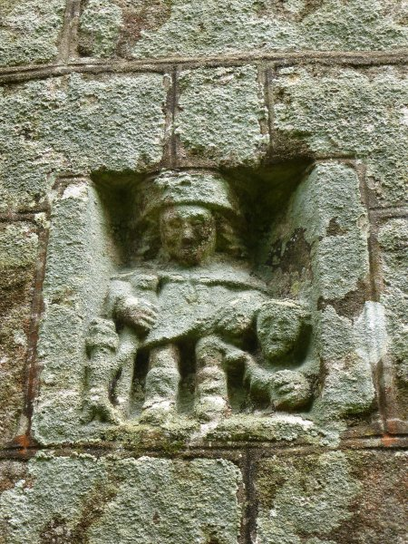 The carving of Saint Roch on the exterior of the chapel of Notre-Dame de la Fosse, Locuon
