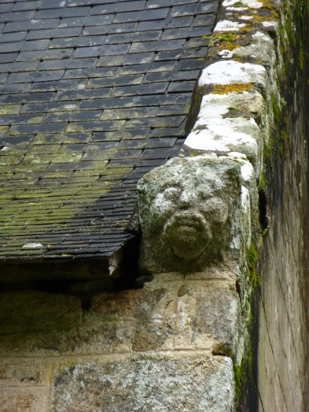 A carved face on the exterior of the chapel of St Gildas, Morbihan