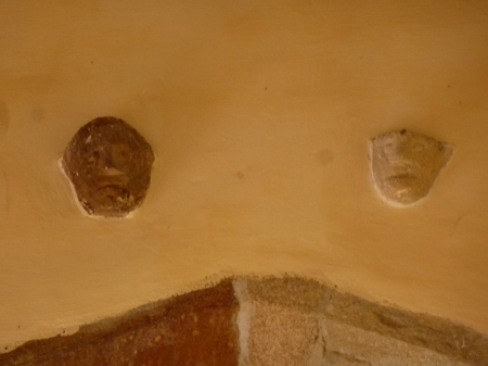 Two intriguing carved faces in the church of Saint-Gobrien, Brittany