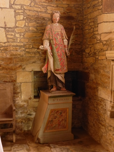 A life size painted sculpture of Saint Etienne in the church of Saint-Gobrien, Brittany